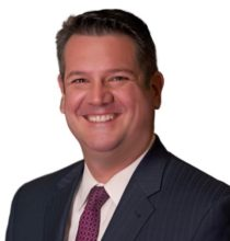 Image of John H. Tinney, Jr. (Jack Tinney) of Hendrickson & Long, PLLC representing a professionally recognized litigation attorney in West Virginia (WV), whose successes span from constitutional challenges to federal white collar criminal defense cases.