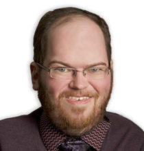 Image of Eric R. Arnold, a West Virginia business litigation attorney and Mountaineer fan who holds an M.B.A.