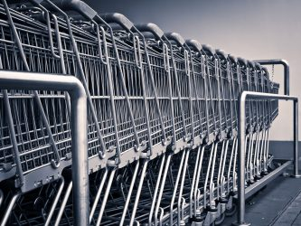 Image of a Row of Shopping Carts, to Illustrate How a Product Liability Lawyer in Kentucky (KY), Pennsylvania (PA), or West Virginia (WV), Can Defend Businesses Fighting Product Liability Lawsuits